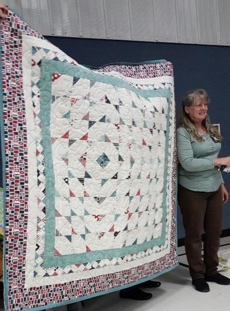 Carol with a Nautical quilt, look close for the anchors