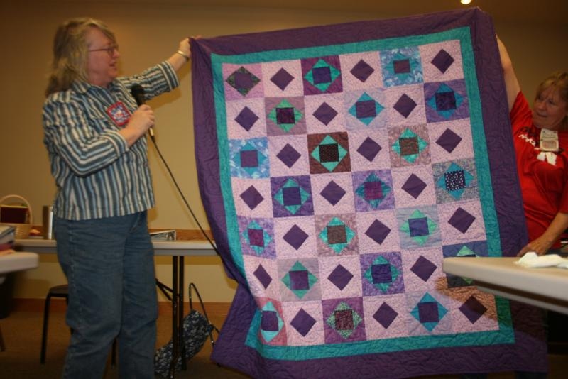 Liz P.-Purple quilt made from BOM blocks she won in 2014