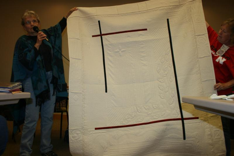 Sharon C,-Lesson I reversible white & ecru with red & black accent strips- hand & machine quilted