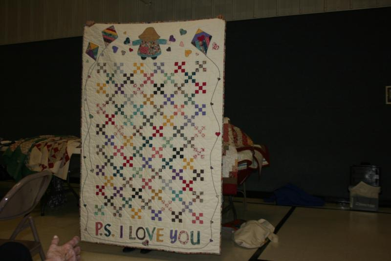 Lari H.-scrappy baby quilt made for her niece