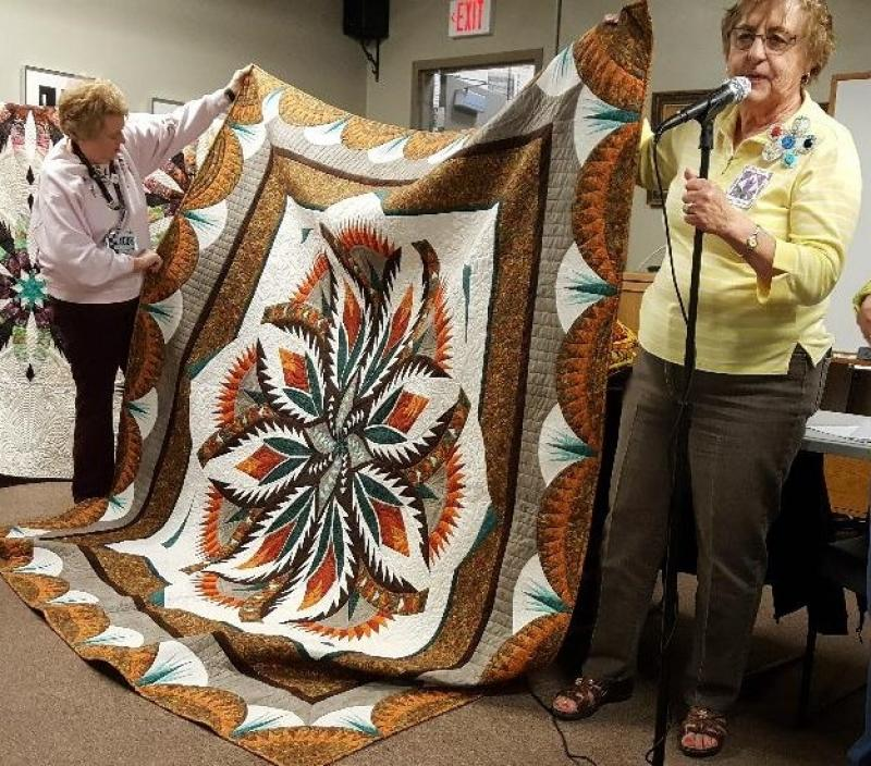 Patsy and Irene have made the same pattern quilt but in different colors