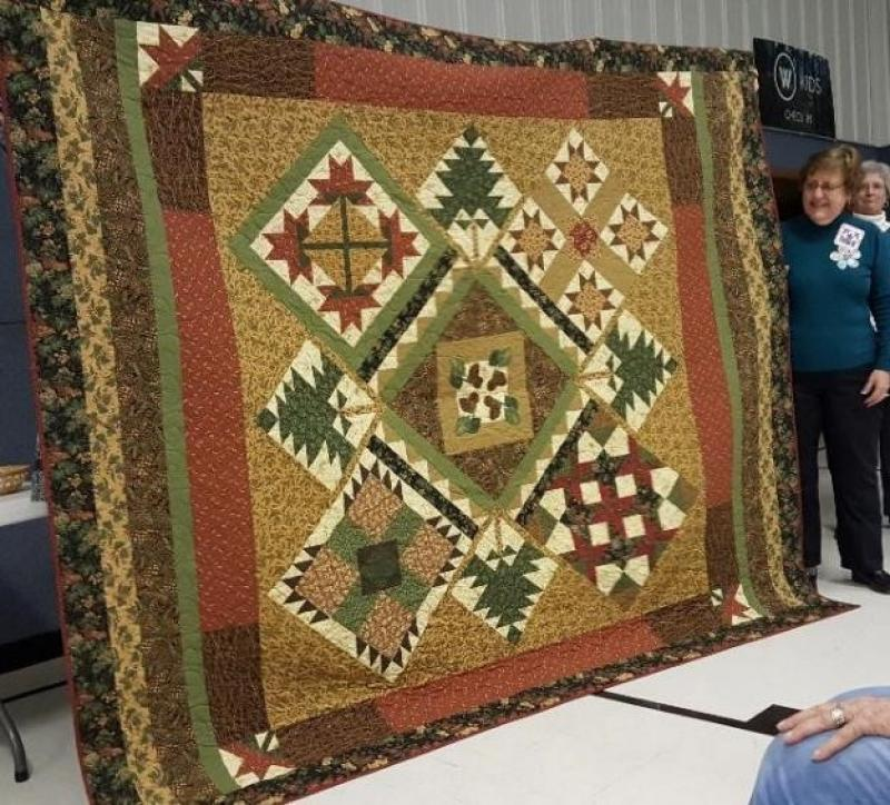 Patsy shows her finished  BOM Quilt