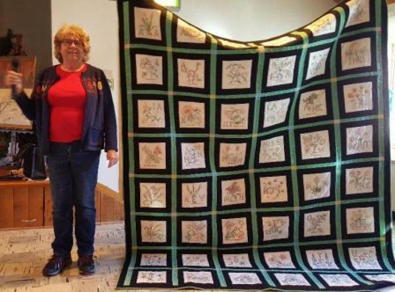 Jan S  State block quilt with black framing and green sashing