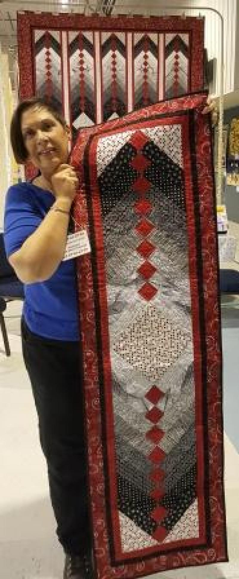 Cindy S won the table runner that coordinates with this year's Serendipity Quilt